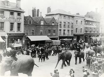 Image of Circus parade in Broad Street, Reading c.1900
